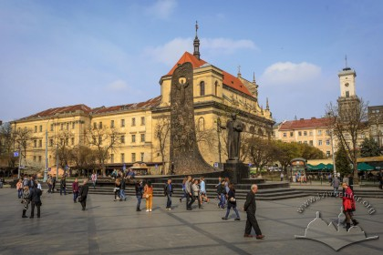 General view of the square with Taras Shevchenko monument in its center. On the background, former Jesuit church and collegium buildings