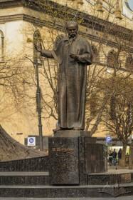 Taras Shevchenko monument on prosp. Svobody. On the background, the former Jesuit church building