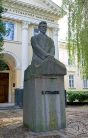 Vasyl Stefanyk monument. On the background, the library building