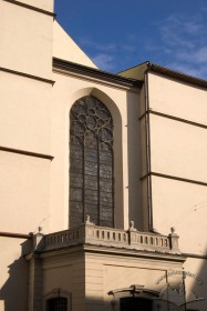 Pl. Katedralna, 1. Part of the western facade, a window with tracery and stained glass