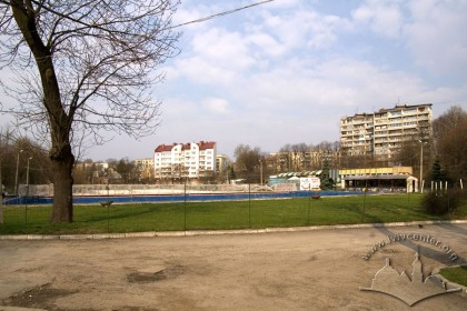 Vul. Horbachevskoho, 24. The swimming pool that is used as a skating ring during winters. Residential buildings of the Morshynska street are seen on the background.