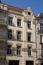 Вул. Чайковського, 6. Фрагмент фасаду з боку просп. Шевченка