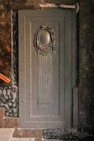 Vul. Halytska, 21. A wooden panel by the entrance